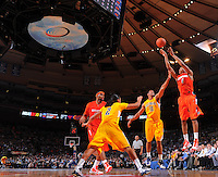 Syracuse forward Wesley Johnson #4 shoots a jumper over California forward Jamal Boykin #10 against the California Golden Bears at the 2K Sports Classic at Madison Square Garden. (Mandatory Credit:Delane Rouse Photography)
