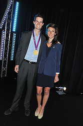 PETER WILSON London 2012 Gold Medal Winner and MICHELLE McCULLAGH at a party to celebrate the launch of the new 2&8 club at Morton's Berkeley Square, London on 27th September 2012.