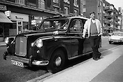 Cab Driver by his taxi, Coram Street, London, UK, 1980s