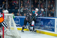 KELOWNA, CANADA - FEBRUARY 14:  Mason McCarty #9 of the Red Deer Rebels checks Braydyn Chizen #22 of the Kelowna Rockets at the boards behind the net on February 14, 2018 at Prospera Place in Kelowna, British Columbia, Canada.  (Photo by Marissa Baecker/Shoot the Breeze)  *** Local Caption ***