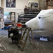 Aurora still with it's head on the floor in the Factory Settings workshop. Aurora is a giant polar bear puppet, the size of a London double decker bus. The bear is the brain child of Greenpeace UK and it will be the center piece in the Greenpeace campaign Save the Arctic  global day of action in London Sept 15th. Aurora is designed by Christopher Kelly in collaboration with props designer Simon Costin and made by Factory Settings in East London.