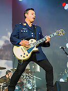 Manic Street Preachers perform on the other stage.The 2014 Glastonbury Festival, Worthy Farm, Glastonbury. 28 June 2013.