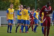 Hollands and Blair players celebrate their second goal during the Southern Counties East match between AFC Croydon Athletic and Hollands & Blair at the Mayfield Stadium, Croydon, United Kingdom on 10 October 2015. Photo by Mark Davies.