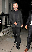 18.JULY.2012. LONDON<br /> <br /> GEORGE MICHAEL AND HIS BOYFRIEND FADI FAWAK LEAVE MADONNA'S WEST LONDON HOME AFTER ATTENDING THE AFTER PARTY FOR MADONNA'S MDNA TOUR. THE MUSIC WAS STILL PUMPING WHEN GEORGE AND HIS PARTNER LEFT AT 12:45AM.  WESTMINSTER COUNCIL NOISE CONTROL ARRIVED AT 2AM FOLLOWING A SECOND COMPLAINT FROM NEIGHBOURS. THE PARTY WAS QUICKLY CLOSED DOWN BY 2:20AM. LONDON UK.<br /> <br /> BYLINE: EDBIMAGEARCHIVE.CO.UK<br /> <br /> *THIS IMAGE IS STRICTLY FOR UK NEWSPAPERS AND MAGAZINES ONLY*<br /> *FOR WORLD WIDE SALES AND WEB USE PLEASE CONTACT EDBIMAGEARCHIVE - 0208 954 5968*