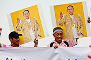 "Apr. 2, 2010 - BANGKOK, THAILAND: Supporters of the Thai monarchy at a peace demonstration in Bangkok, Friday. Thousands of ""Pink Shirts,"" who claim to be neither ""Red Shirts"" nor ""Yellow Shirts"" nicknames for Thailand's dueling political forces, gathered in Lumpini Park in central Bangkok Friday evening to call for ""peace in the land,"" a play on the Red Shirts slogan, ""Red in the Land."" The ""Pink Shirts"" represented educators, business people and people in the tourist industry, all of which have been hurt by the ongoing political protests that have disrupted life in the Thai capital. The ""Pink Shirts"" stressed their loyalty to His Majesty Bhumibol Adulyadej, the King of Thailand, and chanted for the Red Shirts to ""Get Out!"" of Bangkok.    PHOTO BY JACK KURTZ"