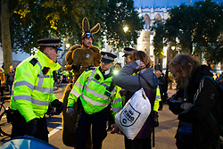 © Licensed to London News Pictures. 09/10/2019. London, UK. Extinction Rebellion activists dress as Kangaroos at a  roadblock in Westminster as police try to remove protesters. Police continue to attempt to clear roads in Westminster on the third day of the protest.  Photo credit: George Cracknell Wright/LNP