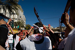 An Ashura celebrator with one of the many knives or swords people march with to commemorate the battle in which Hussein fought and died.