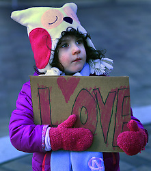 "December 10, 2016 - Washington, DC, USA - CLARA KENT LAVY, 4 years old, from DC holds a sign saying ''Love''.  Children's Rally for Kindness takes place at Trump International Hotel in Washington DC on December 10, 2016 organized by the Takoma Parents Action Coalition.  According to their FaceBook page, it was a call to President-elect Donald Trump: ''to remember these lessons as he prepares to take office and implement policies that will affect the lives of children and families across our diverse nation.''.''All over the world, across cultures and countries, children learn the same basic lessons: .Ã'be kind,Ã"" .Ã'tell the truth,Ã"" .Ã'be fair,Ã"" .Ã'respect everyone,Ã"" .Ã'treat others the way you want to be treated,Ã"" .Ã'donÃ•t touch others if they donÃ•t want to be touched. (Credit Image: © Carol Guzy via ZUMA Wire)"