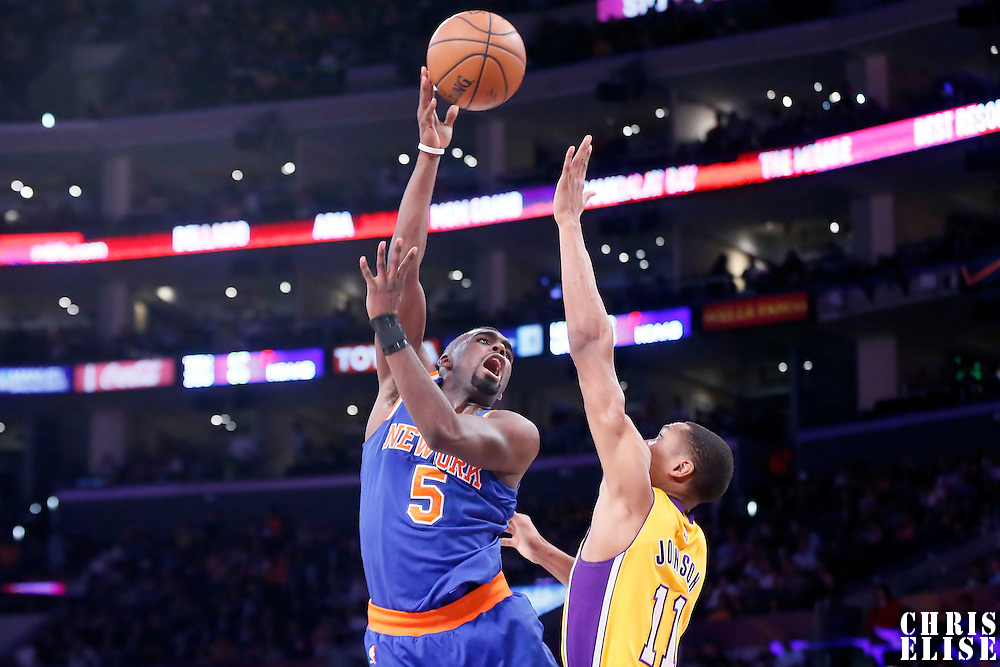 12 March 2015: New York Knicks guard Tim Hardaway Jr. (5) goes for the sky hook over Los Angeles Lakers forward Wesley Johnson (11) during the New York Knicks 101-94 victory over the Los Angeles Lakers, at the Staples Center, Los Angeles, California, USA.