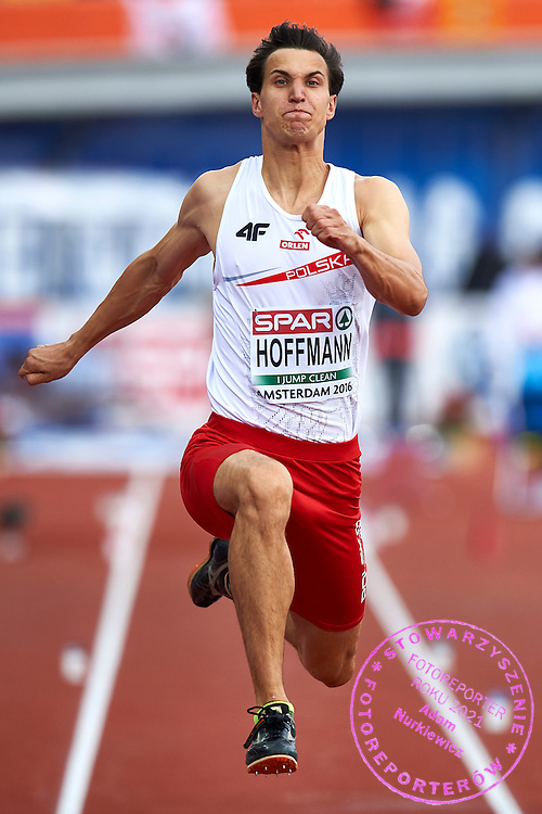 Amsterdam, Netherlands - 2016 July 09: Karol Hoffmann (MKS Aleksandrow Lodzki) from Poland competes in men&rsquo;s triple jump during European Championships Athletics 2016 at Olympic Stadium on July 09, 2016 in Amsterdam, Netherlands.<br /> <br /> Adam Nurkiewicz declares that he has no rights to the image of people at the photographs of his authorship.<br /> <br /> Picture also available in RAW (NEF) or TIFF format on special request.<br /> <br /> Any editorial, commercial or promotional use requires written permission from the author of image.<br /> <br /> Mandatory credit:<br /> Photo by &copy; Adam Nurkiewicz