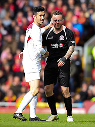 Luis Garcia jokes with Jay Spearing - Photo mandatory by-line: Dougie Allward/JMP - Mobile: 07966 386802 - 29/03/2015 - SPORT - Football - Liverpool - Anfield Stadium - Gerrard's Squad v Carragher's Squad - Liverpool FC All stars Game