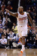 Jan 6, 2016; Phoenix, AZ, USA; Phoenix Suns forward P.J. Tucker (17) points after scoring a three point basket in the second half of the game against the Charlotte Hornets at Talking Stick Resort Arena. The Phoenix Suns defeated the Charlotte Hornets 111-102. Mandatory Credit: Jennifer Stewart-USA TODAY Sports