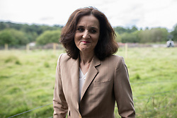© Licensed to London News Pictures. 03/08/2019. Whaley Bridge, UK. THERESA VILLIERS , Secretary of State for Environment, Food and Rural Affairs , speaks to media , close to the reservoir . The town of Whaley Bridge in Derbyshire remains evacuated after heavy rain caused damage to a slipway on the Toddbrook Reservoir , threatening homes and businesses with flooding. Photo credit: Joel Goodman/LNP
