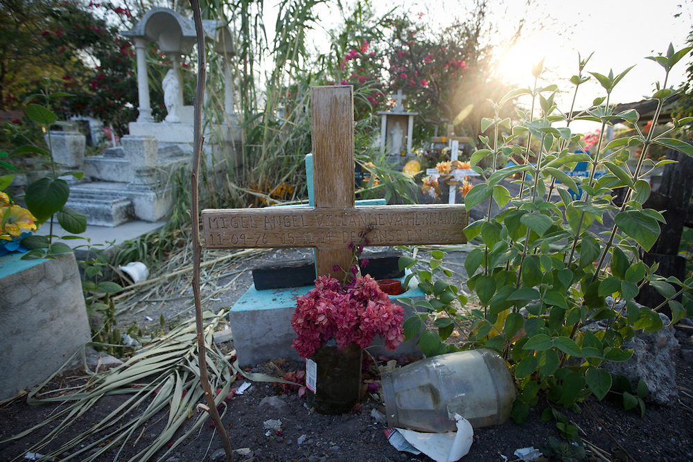 A grave of a drug dealer who was murdered in December 2014 when one cartel was taking over the territory from the other.