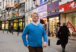 """Dom Joly films """"In Search of Tintin"""" in Brussels, Belgium,  Wednesday, Jan. 6, 2010. The television special will be broadcast on Channel 4 in the UK in March 2010. Dominic John """"Dom"""" Joly is a British television comedian and journalist. He came to note as the star of Trigger Happy TV, a hidden camera show that was sold to over seventy countries worldwide. Since then, Joly has continued to make edgy off-beat television like World Shut Your Mouth for BBC1 and Dom Joly's Happy Hour, a spoof travel show for Sky One. Joly is also an author with several books to his name, and an award-winning travel writer for both the Sunday Times and the Mail On Sunday. He writes several regular columns for various UK nationals and periodicals including a weekly sports column for The Independent and an eclectic weekly column for the Independent on Sunday. (Photo © Jock Fistick)"""