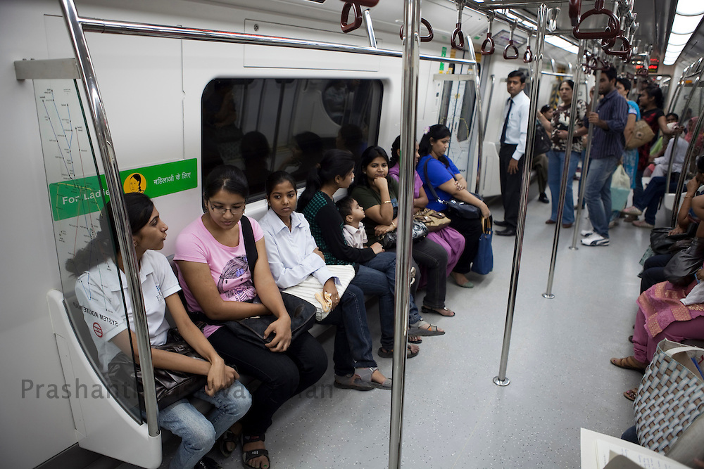 "Passengers travel inside a metro train from the Central Secratariat station using the ""Yellow Line"" route of the Delhi Metro network in New Delhi, India, on Friday, October 22, 2010. Photographer: Prashanth Vishwanathan/HELSINGIN SANOMAT"