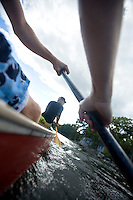 Young men paddling canoe on Lake Sebago, Maine