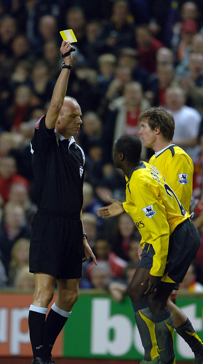Photo: Paul Greenwood.<br />Liverpool v Arsenal. The FA Cup. 06/01/2007. Arsenal's Emanuel Eboue is yellow carded for persistant time wasting by match referee Steve Bennett
