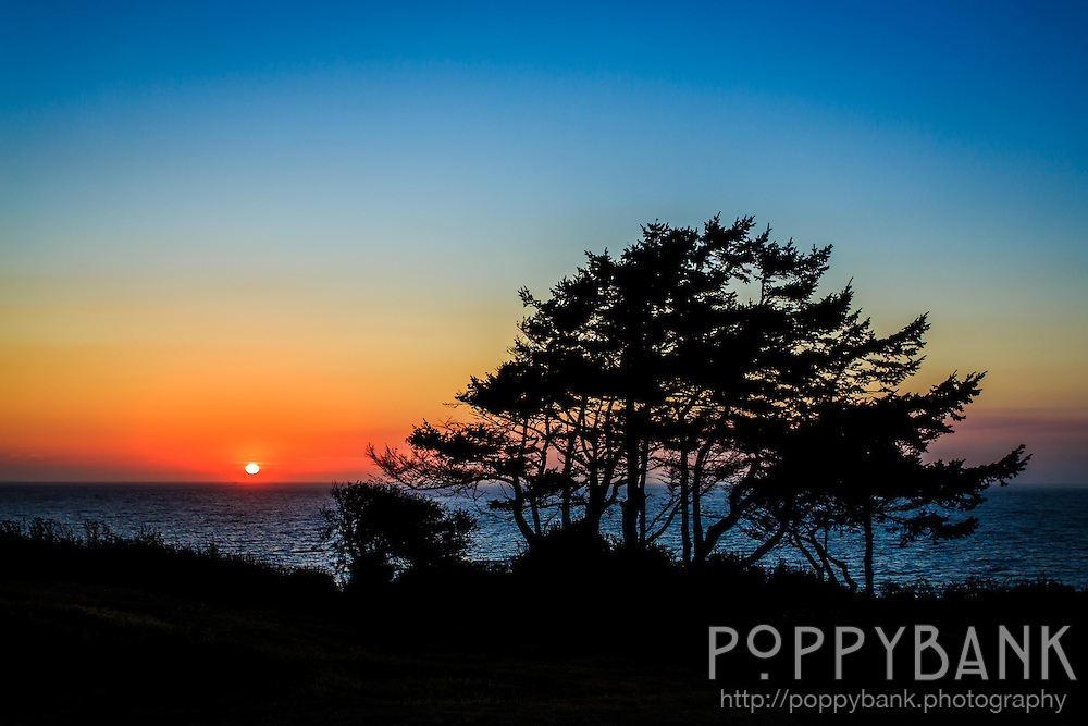 Sunset across the Puget Sound from Fort Casey State Park on Whidbey Island, Washington