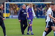 AFC Wimbledon manager Wally Downes with arm around AFC Wimbledon goalkeeper Aaron Ramsdale (35) during the EFL Sky Bet League 1 match between AFC Wimbledon and Gillingham at the Cherry Red Records Stadium, Kingston, England on 23 March 2019.