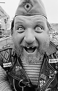 Portrait of Max, a biker looking happy, Guernsey 1986