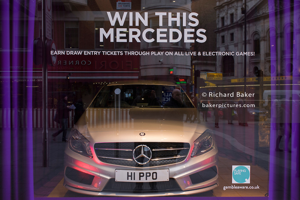 Win this Mercedes in a central London amusement arcade, a temptation for gamblers to enter an electronic draw.