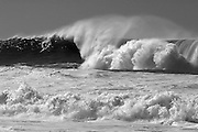 A surfer catching a wave in the Mavericks big wave surfing competition near Half Moon Bay, CA on February 7, 2006. (Charles Hall/challphotos.com)