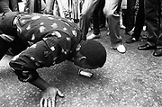 Black man performing a trick, Notting Hill Carnival,  London, UK, 1983