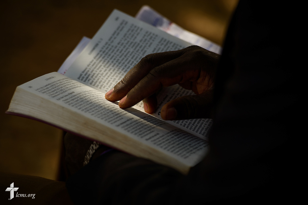 The Rev. Remi Lare Lambon, pastor in the Lutheran Church of Togo, leads a devotion during a visitation on Tuesday, Feb. 14, 2017, at a rural home in Sankpong, Togo.  LCMS Communications/Erik M. Lunsford