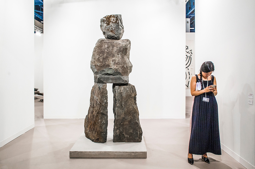 Visiter uses cell phone at Art Basel Miami Beach 2015