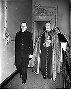 "21/12/1952<br /> 12/21/1952<br /> 21 December 1952<br /> Most Rev. Dr. Gerald O'Hara, (right) Papal Nuncio to Ireland with Fr. Thackcherry arriving at the Capitol Theatre Dublin for Our Lady's Choral Society and the Radio Eireann Symphony Orchestra's production of Handel's ""Messiah""."