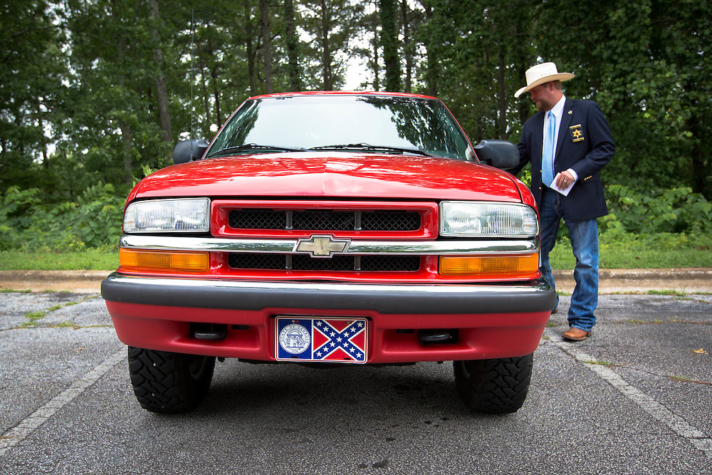 Brandon Heath, chief magistrate judge for Haralson County (Ga.), gets in his pickup at the Haralson County Courthouse in Buchanan, Ga. on Thursday, July 2, 2015. The tag on his truck is of a previous state flag for Georgia that contains the Confederate battle flag and flew in the state from 1956-2001. Shot for a story about changes occurring in the South following a heightened national awareness and sensitivity concerning the Confederate battle flag. Photo by Kevin Liles for The New York Times