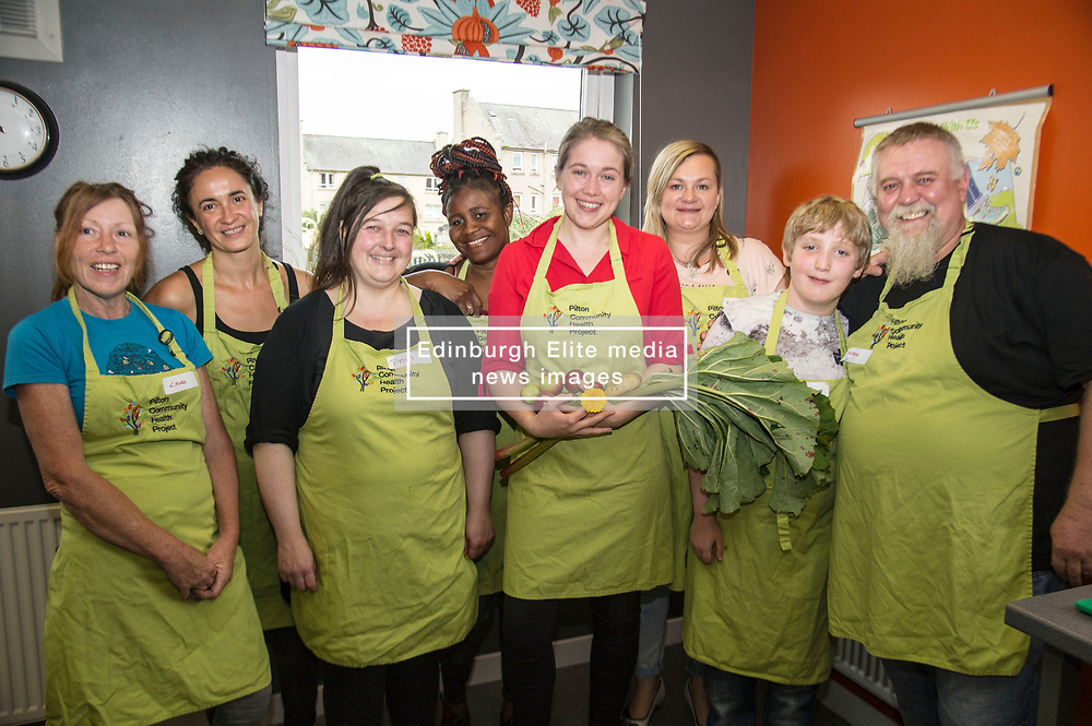 Pictured: Aileen Campbell was joined by Malcolm and Sean Fitzharris, Laura Munro, Mary Paddy and Kinga Lesniak among others for the group shot.<br /> Public Health Minister Aileen Campbell joined a class at the Pilton Community Health Project which helps families gain confidence in the kitchen, ahead of the Scottish Government's consultation on its diet and obesity strategy being launched in the autumn<br /> Ger Harley | EEm 10 August  2017