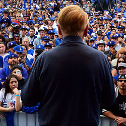 Hall of Fame broadcaster Vin Scully looks upon thousands as he tell a story during the fourth annual offseason FanFest on Saturday, Jan. 30, 2016 in Los Angeles.