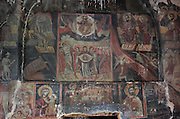 Frescoes, including Christ's ascension, Virgin and child, Mary holding the shroud, various saints and angels and part of the Day of Judgement, in the narthex of the Holy Resurrection Church or Kisha e Ristozit, 14th century, Mborje, Korce, Albania. The church, dedicated to St Mary, is a Cultural Monument of Albania. Picture by Manuel Cohen