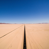 Africa, Namibia, Aerial view of highway passing through Namib Desert near abandoned town of Garub