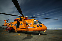 A CH-149 Cormorant Search and Rescue helicopter remains on alert on the tarmac at CFB Comox.  Comox , The Comox Valley, Vancouver Island, British Columbia, Canada.