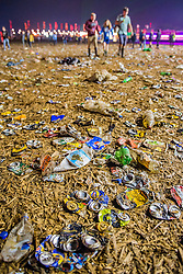 The rubbish is trampled into the mud or overflowing in bins in the now empty Other Stage crowd area - the festival motto is 'Leave no trace'.The 2015 Glastonbury Festival, Worthy Farm, Glastonbury.