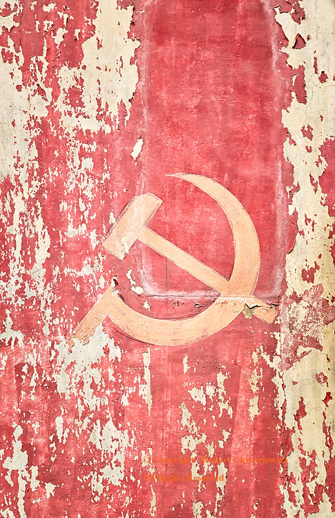 Yesterdays Ideals: The weathered remnant of the communist regime, the hammer and sickle, once a new proud ideal has come to represent the discarded aspirations of an old regime as the country rapidly sheds its ardent socialist past, Luang Prabang Laos.