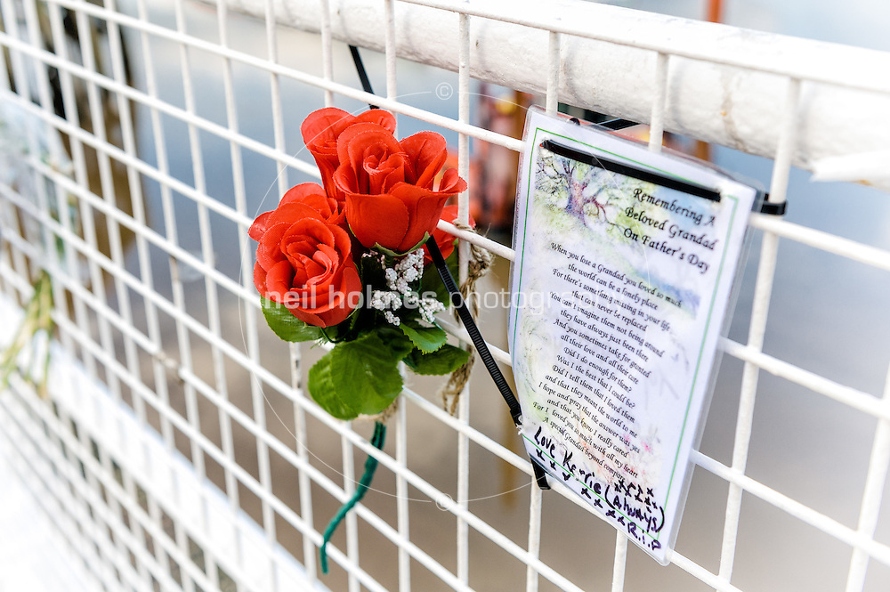 Fathers day card & red roses left on Hull Pier, Humber June 27, 2012.