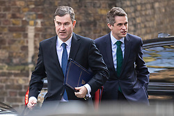 © Licensed to London News Pictures. 26/03/2019. London, UK. Justice Secretary David Gauke (L) and Defence Secretary Gavin Williamson (R) arrive on Downing Street for the Cabinet meeting. MPs have passed an amendment which gives Parliament a series of indicative votes on alternatives to Prime Minister Theresa May's Brexit deal. Photo credit: Rob Pinney/LNP