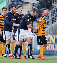 Falkirk's David McCracken gets held by Alloa Athletic's Mitchell Megginson. <br /> Falkirk 2 v 0 Alloa Athletic, Scottish Championship game played 5/3/2016 at The Falkirk Stadium.
