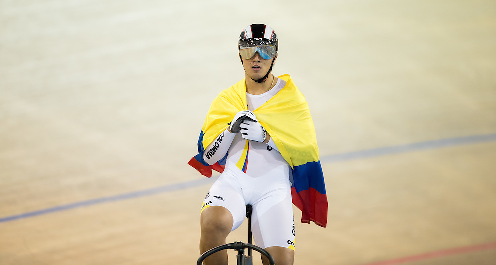 Fabian H. Puerta Zapata of Colombia celebrates his gold medal win in the men's cycling keirin at the 2015 Pan American Games in Toronto, Canada, July 19,  2015.  AFP PHOTO/GEOFF ROBINS