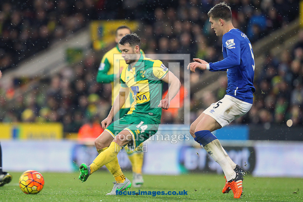 Wes Hoolahan of Norwich and John Stones of Everton in action during the Barclays Premier League match at Carrow Road, Norwich<br /> Picture by Paul Chesterton/Focus Images Ltd +44 7904 640267<br /> 12/12/2015