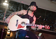 TAMPA, FL - JANUARY 31: Multi-platinum recording artist, television personality and radio host Dave Navarro performs at the Rock-N-Babes Party with Dave Navarro and Playboy Playmates at the Hula Bay Club on January 31, 2009 in Tampa, Florida.  (Photo by Matt Stroshane/Wire Image for BrandIT Group) *** Local Caption ***