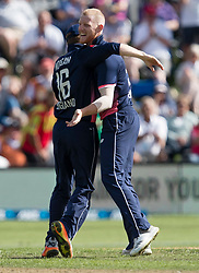 England's Ben Stokes, right, celebrates taking the wicket of New Zealand's Kane Williamson with Eoin Morgan in the fourth one day cricket international at the University of Otago Oval, Dunedin, New Zealand, Wednesday, March 7, 2018. Credit:SNPA / Adam Binns ** NO ARCHIVING**