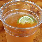 A Corona beer with a lime wedge served in a plastic cup and enjoyed at a tiki bar in Long Branch, New Jersey, USA