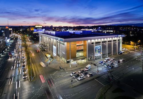 Illuminated Shopping Center Kaubamaja In Tartu, Estonia. Aerial, Street,  Twilight, City.