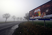 Mezirici/Tschechische Republik, CZE, 11.12.06: Bier Werbung in einer S&uuml;d-B&ouml;hmischen Landschaft im Nebel in der N&auml;he des Dorfes Mezirici.<br /> <br /> Mezirici/Czech Republic, CZE, 11.12.06: South Bohemian landscape close to the village Mezirici in foggy weather with a beer commercial on a billboard.