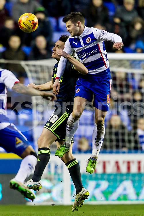 Oliver Norwood of Reading challenges for the ball during the Sky Bet Championship match between Reading and Middlesbrough at the Madejski Stadium, Reading, England on 10 January 2015. Photo by Gareth  Brown.